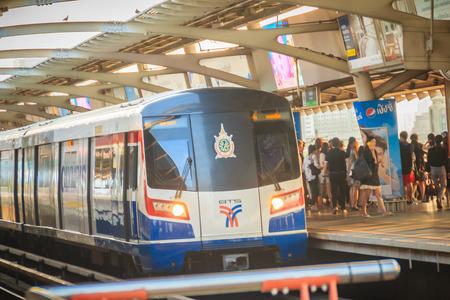 Bangkok, Thailand - March 8, 2017: BTS sky train arriving and stop on platform at Mochit BTS station.