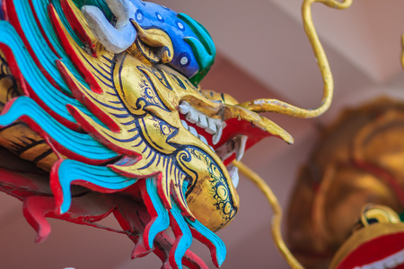 Colorful dragon sculpture at the entrance stair in Chinese temple