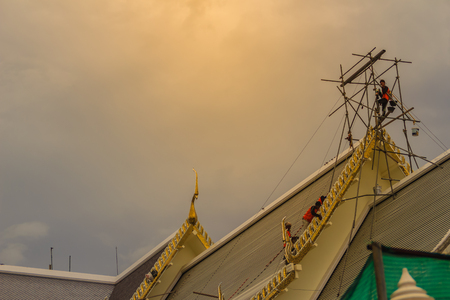Chachoengsao, Thailand - May 12, 2017: Unidenitified workers during repair roof of the church in Wat Sothonwararam, a famous public temple in Chachoengsao Province, Thailand.