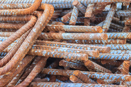 Rusty deformed bars for reinforcement concrete background. Rusty Re-bar steel or deformed bar material for building construction.