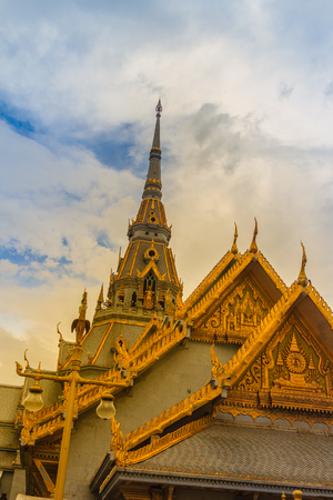 Beautiful Thais style craving and decoration on the golden gable end at Wat Sothonwararam, a famous public temple in Chachoengsao Province, Thailand.