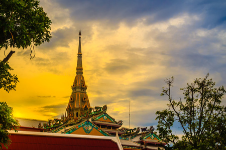 Beautiful golden pagoda at Wat Sothonwararam, a famous public temple in Chachoengsao Province, Thailand.