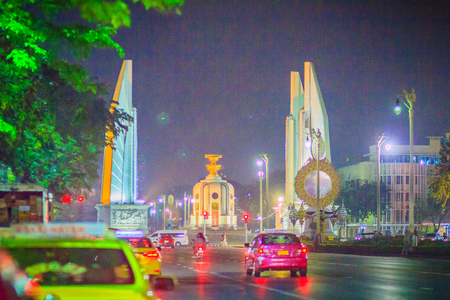 Bangkok, Thailand - March 2, 2017: The democracy monument at night with colorful light and traffic jam. Editorial