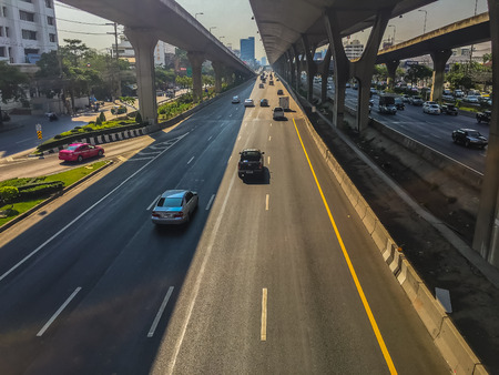 hi speed: Bangkok, Thailand - March 14, 2017: Traffic flow at the street in front of Central Bangna department store, Bangna-Trad expressway from Bangkokk to Trad province, the far eastern part of Thailand.