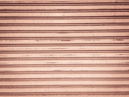 shutter: Vintage old roller shutter garage door. Grungy metallic roller shutter door for background.