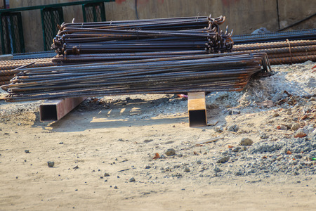 assembled: Bent deformed steel bars ready for reinforced concrete work. Cut and bent steel bars prepared for reinforcing concrete.