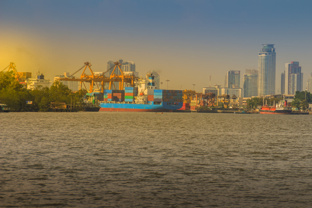 klong: View of Bangkok Port Authority of Thailand or Klong Toey port along Chao Phraya river in Bangkok,Thailand. Heavy crane tool in ship port and container yard use for import and export. Stock Photo