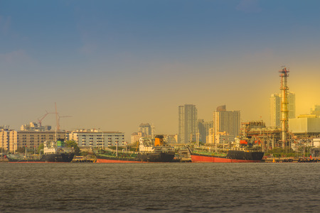 View of Bangkok Port Authority of Thailand or Klong Toey port along Chao Phraya river in Bangkok,Thailand. Heavy crane tool in ship port and container yard use for import and export. Stock Photo