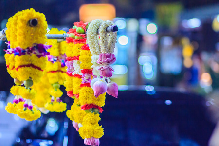 Colorful marigold flower garlands for hindu religious ceremony. Garland of indians for worship goddess in the florist shop nearby Sri Maha Mariamman Temple, Silom, Bangkok, Thailand.