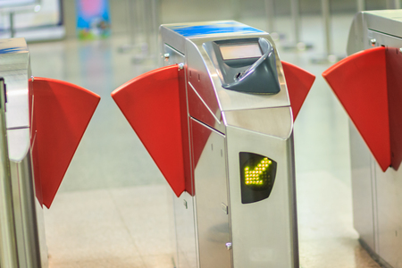Automatic access control ticket barriers in subway station. View of barrier gate before access in to subway station. Automatic ticket barriers at subway entrance.