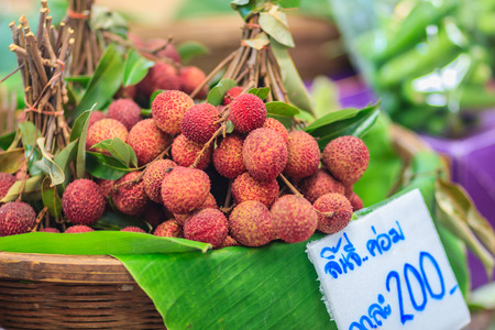 Fresh lychee fruit for sale at the fresh market. Lychee also variously spelled as litchi, liechee, liche, lizhi or li zhi, or lichee, a tropical tree native to the Guangdong province of China.