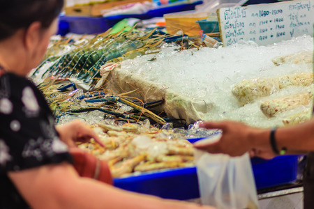 expensive: Unidentified woman at the seafood market is buying the extra large size of giant malaysian prawn (Macrobrachium rosenbergii) also known as the giant river prawn or giant freshwater prawn.