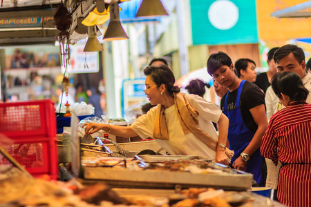 Bangkok, Thailand - April 23, 2017: Unidentified buyer is buying for soft shelled crabs at the Or Tor Kor fresh market. Located near the famous Chatuchak weekend market.