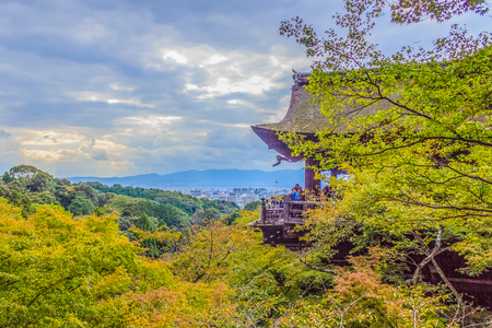 View of Kyoto city from Kiyomizu temple with dramatic cloudy sky on background.