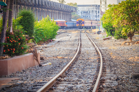 complicated journey: Bangkok, Thailand - April 23, 2017: Perspective railway landscape of free and empty railway lines. Detailed picture of rails and sleepers at Hua Lamphog railway station in Bangkok, Thailand.