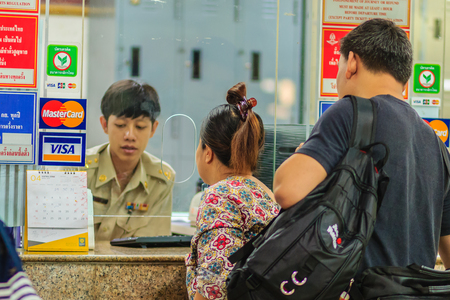 Bangkok, Thailand - April 23, 2017: Unidentified backpacker tourist is buying for train ticket at Hua Lamphong railway station, the main railway station in Bangkok, Thailand.