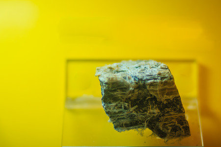 Asbestos rock specimen from mining and quarrying industries. Asbestos is a set of six naturally occurring silicate minerals, which all have in common their eponymous asbestiform habit.