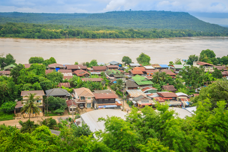 Beautiful landscape view of border village nearby Mun River Mouth, the point where the Mun and Mekong join in Khong Chiam District, the easternmost district of Ubon Ratchathani Province of Thailand. Stock Photo
