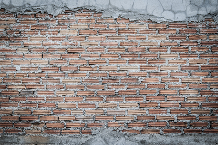 Unfinished brick wall plastering background with copy space. Under plastering brick wall texture as a creative background. Stock Photo