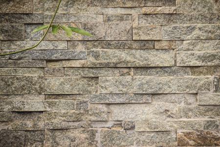 hermoso patrón de fondo decorativo de piedra de pared antigua. pared de piedra de la vendimia textura en la pared y las superficies pintadas brillantes para el diseño de fondo . arte del color pintado contraste de la textura de piedra antigua