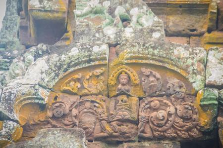 lintel: Beautiful sandstone craved on the lintel, doorway and windows of Lord Krishna killing Lion in Bapuan Khmer art at Phra That Narai Cheng Weng, Sakon Nakhon, Thailand.