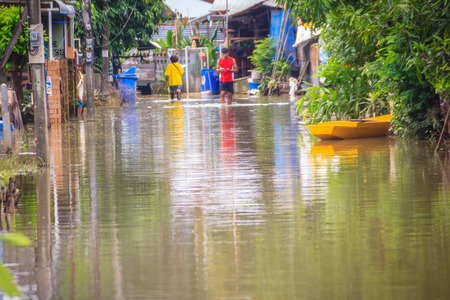 Sakon Nakhon, Thailand - August 4, 2017: Difficulty transportation in a heavy flooding situation in urban Sakon Nakhon, Thailand. The heavy flood in Sakon Nakhon after tropical storm SONCA.