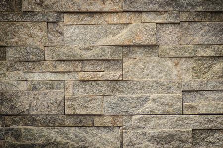 Mooi patroon van de oude decoratieve achtergrond van de steenmuur. Vintage stenen muur textuur in verweerde en hebben natuurlijke oppervlakken voor ontwerp achtergrond. Gekenmerkte patroon grijze kleur van antieke steenmuur. Stockfoto