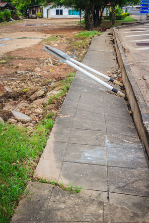 Concrete footpath is slipping after flood. Flood is causing erosion and landslide to the footpath in the city.