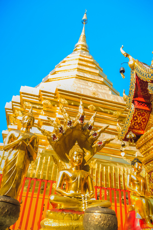 Beautiful northern Thai style architectural of golden church and pagoda at Wat Phra That Doi Suthep, the famous temple and became the landmark of Chiang Mai, Thailand.