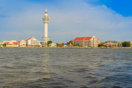 Riverfront view of Samut Prakan city hall with new observation tower and boat pier. Samut Prakan is at the mouth of the Chao Phraya River on Gulf of Thailand. Editorial