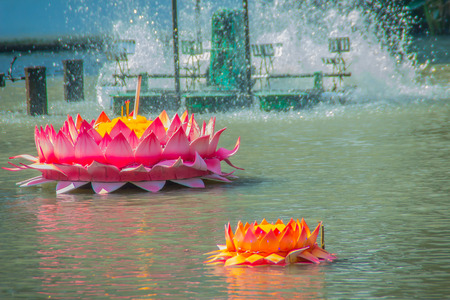 Beautiful pink and orange kratongs are floating on the water. Conccept for loy kratongs festival celebrated in Thailand.