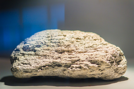 Pumice or pumicite stone specimen for education. Pumice is a volcanic rock that consists of highly vesicular rough textured volcanic glass, which may or may not contain crystals.