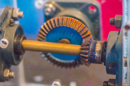 Sample of bevel gear set. Bevel gears are gears where the axes of the two shafts intersect and the tooth-bearing faces of the gears themselves are conically shaped on shafts that are 90 degrees apart.