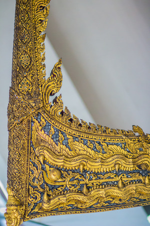 Beautiful traditional Thai style craving patterned of Samatthachai royal barge. Monster head craved pattern in thai royal barge. Stock Photo