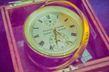 Vintage old marine chronometer, a timepiece that is precise and accurate enough to be used as a portable time standard; it can therefore be used to determine longitude by means of celestial navigation Editorial