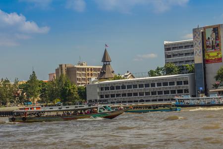 Bangkok, Thailand - November 29, 2017: Tha Pra Chan pier, a pier on the historic Bangkok, located on the eastern bank of the Chao Phraya River and beside Thammasat Universitys campus.