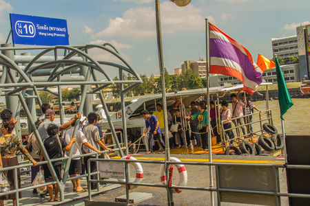 Bangkok, Thailand - November 29, 2017: Wang Lang pier, or Prannok or Siriraj pier is located along the west bank of the Chao Phraya River or Thonburi side an d opposite of Thammasat University. biên tập