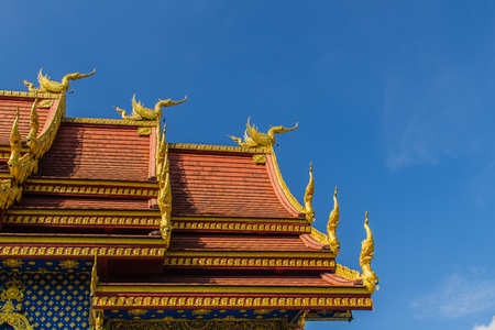 Beautiful swan and naga sculptures on the church roof under the blue sky background at Wat Rong Suea Ten Temple, also known as the Blue Temple, locate at Chiang Rai province, northern part of Thailand Stock Photo