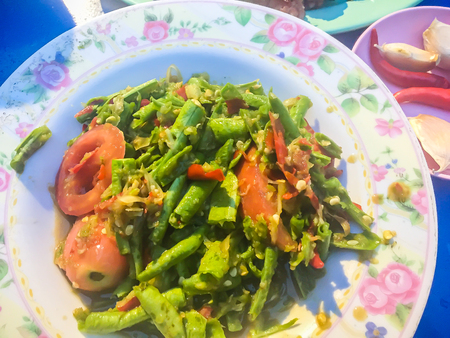 Yard long bean spicy salad Thai street food menu that you don't miss. This is another dish of spicy salad that you will also get from Papaya Salad Restaurants.