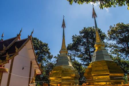 Beautiful golden pagodas at Wat Phra That Doi Tung, Chiang Rai. Wat Phra That Doi Tung comprises of a twin Lanna-style stupas, one of which is believed to contain the left collarbone of Lord Buddha.