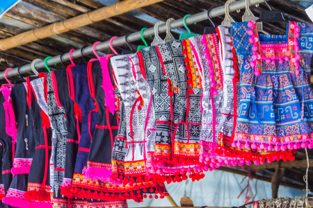 Beautiful traditional handmade clothes for sale to the tourist as the souvenir at the local market in hill tribe minority village at northern Thailand.