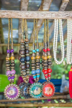 Colorful tribal beads and necklaces souvenir for sale on street at the local market, Chiang Rai, Thailand. Stok Fotoğraf
