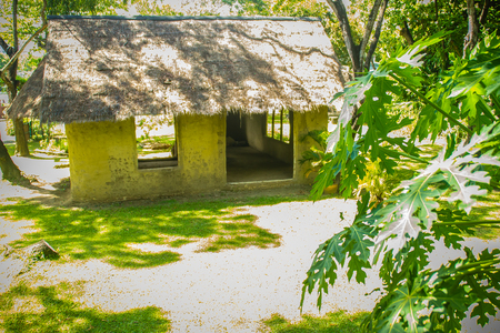 Earthen house under shade of trees. An earth house, also known as earth berm, earth sheltered home, or eco-house is an architectural style by use the natural terrain to help form the walls of a house.