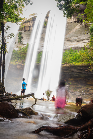 Huai Luang Waterfall, also known as Namtok Huai Luang or Namtok Bak Teo. The waterfall is plunging down three steps from an elevation of 30 meters with pool, white beach and turquoise colored water.