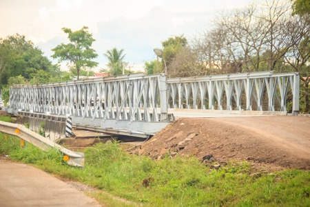 New temporary steel bridge is replace the reinforce concrete bridge during flood damage at the highway.