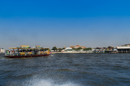 Chao Phraya riverfront view from boat along the Choa Phraya river, Bangkok, Thailand.