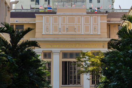 Bangkok, Thailand - December 21, 2017: Old neo-classical style building of Faculty of Medicine Siriraj Hospital at the Siriraj hospital, the oldest and largest hospital in Thailand, founded in 1888.
