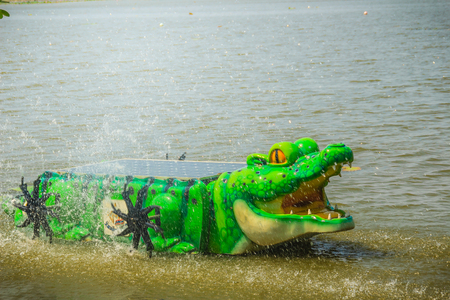 Cute crocodile water turbine with solar panel for water treatment increasing oxygen in the water at Bueng See Fai, the public park with lake at Muang district, Pichit province, Thailand.
