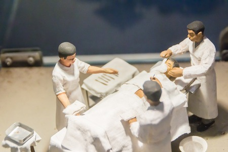 Bangkok, Thailand - December 21, 2017: Small models of surgeon in operation room in the hospital at the Siriraj hospital public museum, the oldest and largest hospital in Thailand, founded in 1888.
