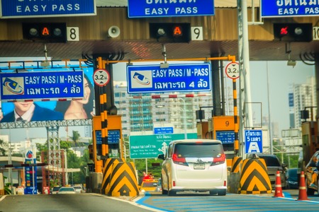 Bangkok, Thailand - March 26, 2018: Extra blue easy pass lane to paying the easy pass tolls fee at the automated tollbooth that faster and easier than the normal cash payment lane. Editorial